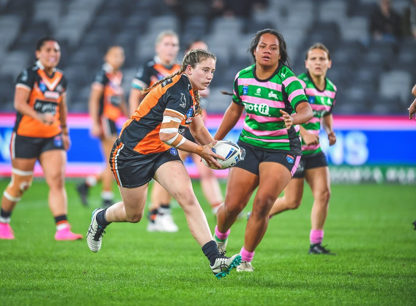 Emily Curtain on the charge for the Wests Tigers.
