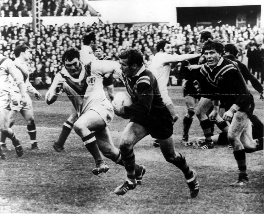 St George halfback Billy Smith tries to outpace British prop Cliff Watson during a match for Australia against Great Britain, 1970.