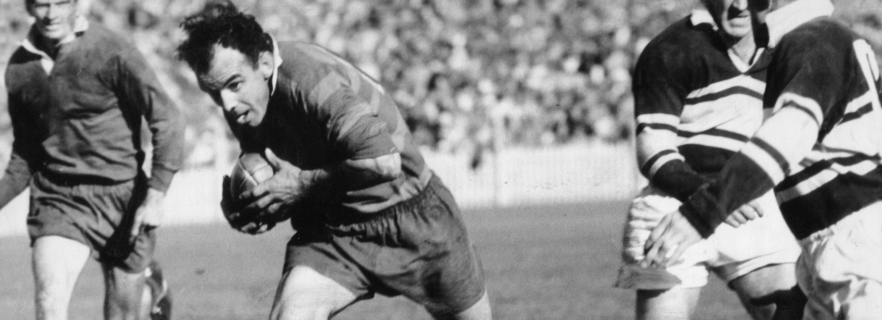 Clive Churchill playing for Souths against Wests in the 1950s.