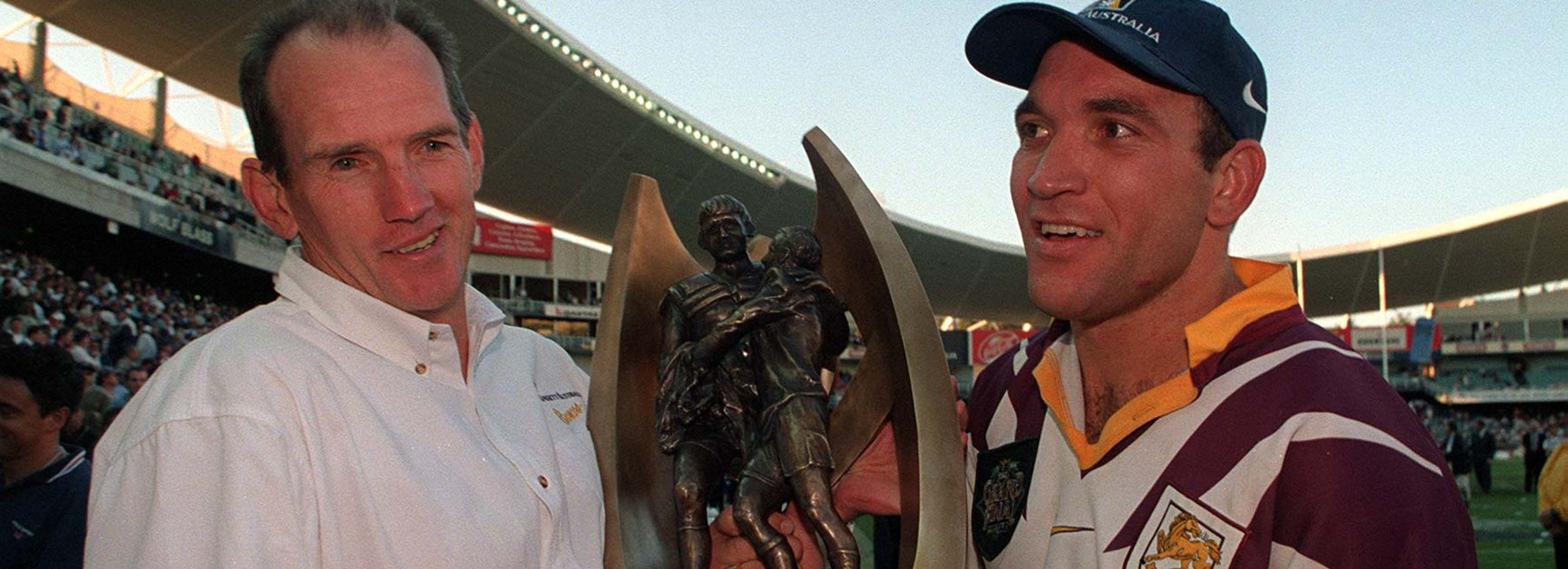 Gorden Tallis with Broncos coach Wayne Bennett after the Broncos' 1998 NRL Grand Final victory.