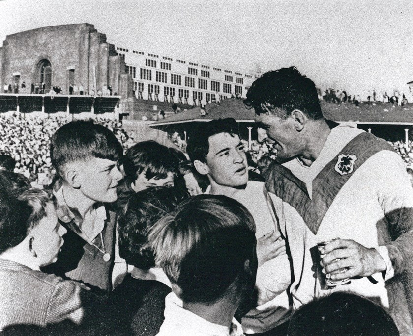 After fulltime of the 1965 Grand Final Provan talks to some young fans on field ahead of the presentation.