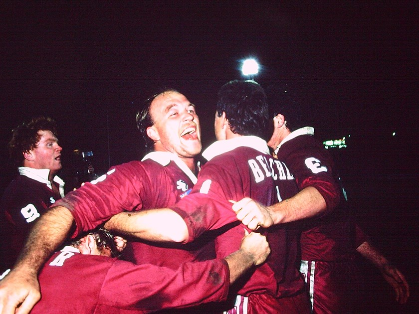 Wally Lewis embraces his Maroons teammates after their 1987 series win.