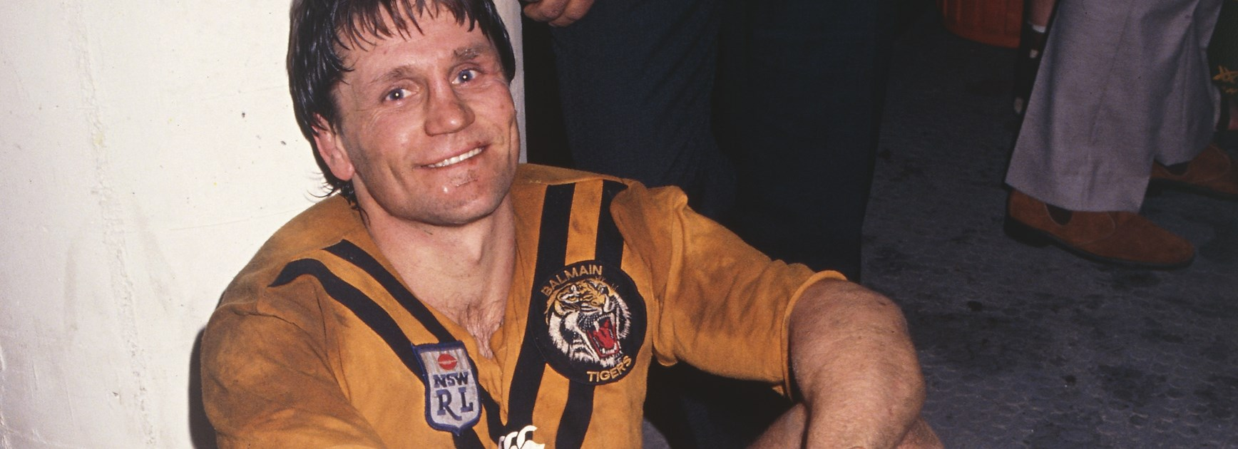 An exhausted Pearce relaxes in the dressing rooms after another Balmain win.