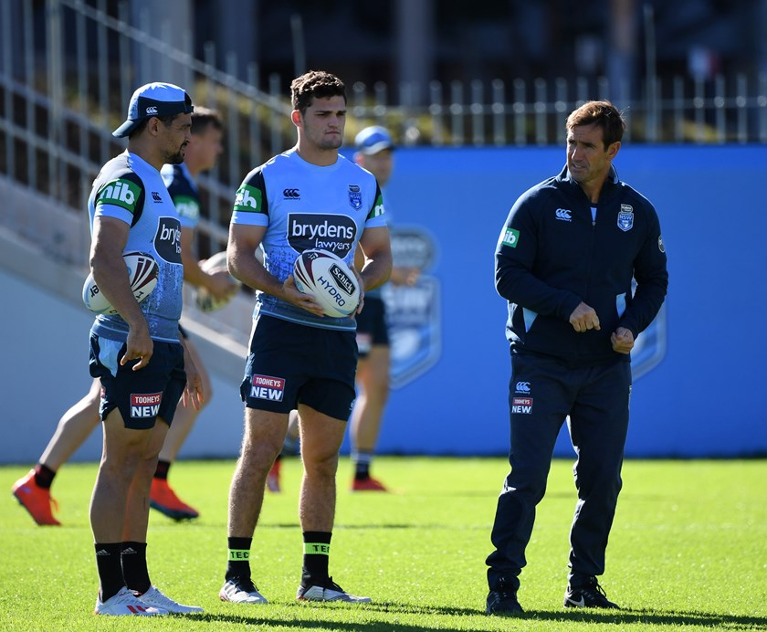Blues halves Cody Walker and Nathan Cleary with assistant coach Andrew Johns in 2019.