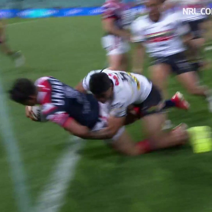 Latrell Mitchell barges over