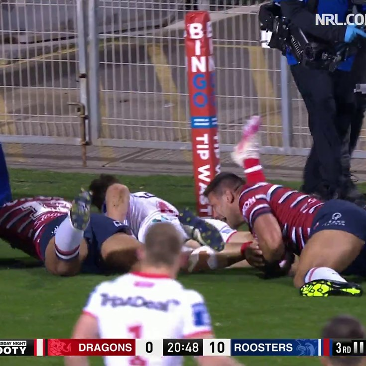 Lomax beats several Roosters to score