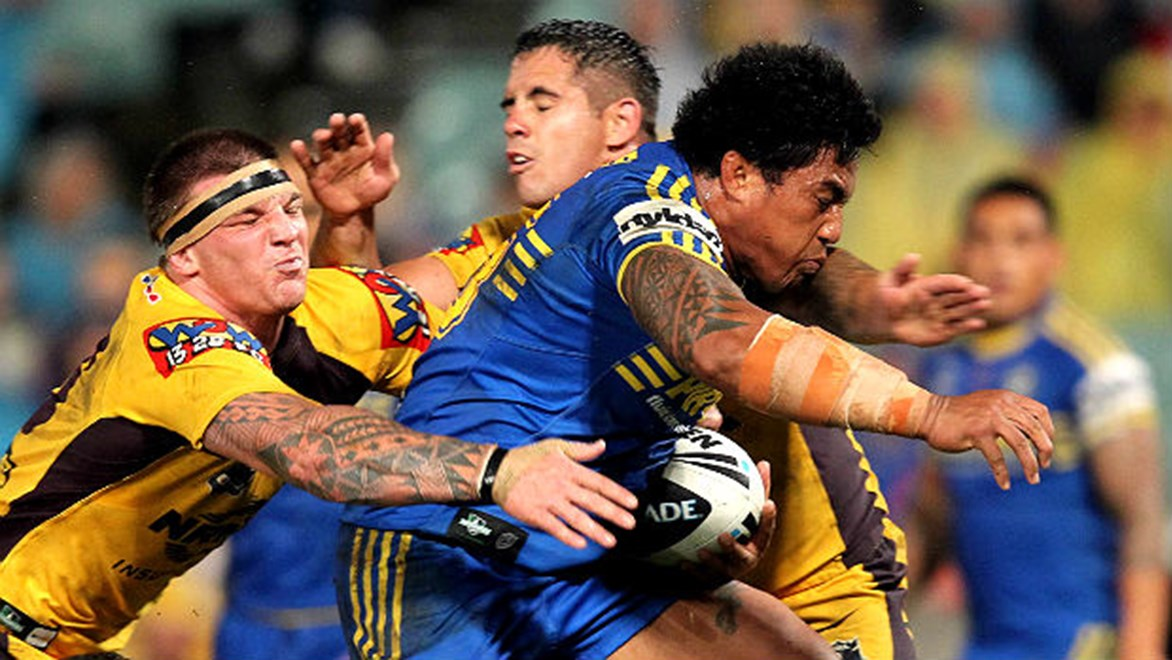Fuifui Moimoi attempts to bust through the defence of Bronco Corey Parker