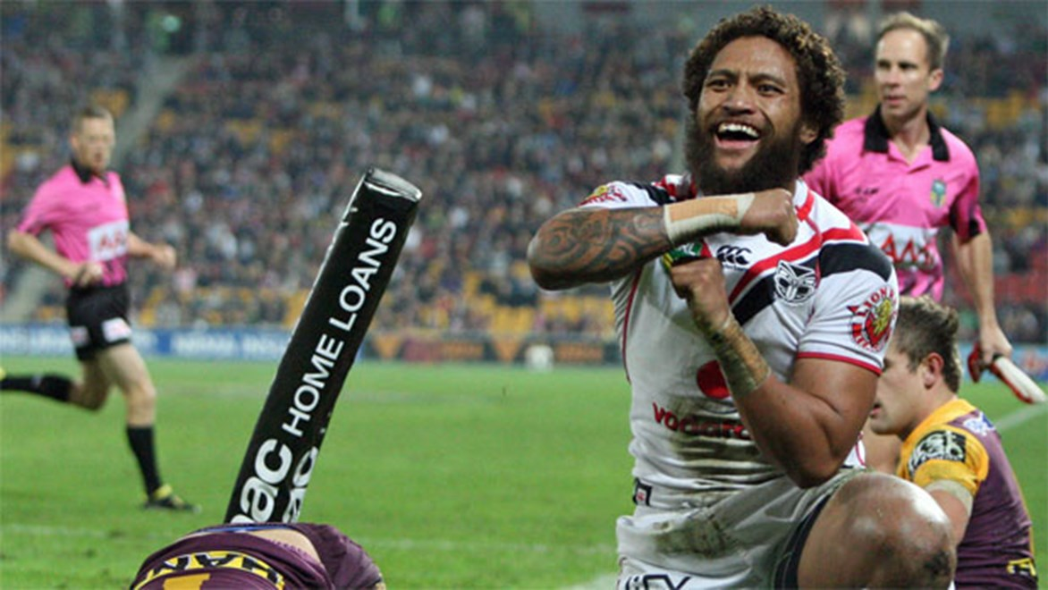 Warriors winger Manu Vatuvei celebrates a try against the Broncos