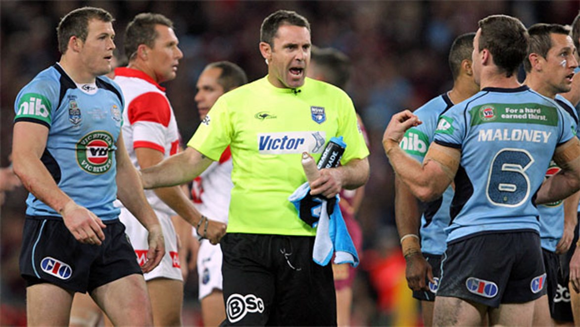 NSW assistant Brad Fittler (centre) speaks to Josh Morris and James Maloney during Origin II