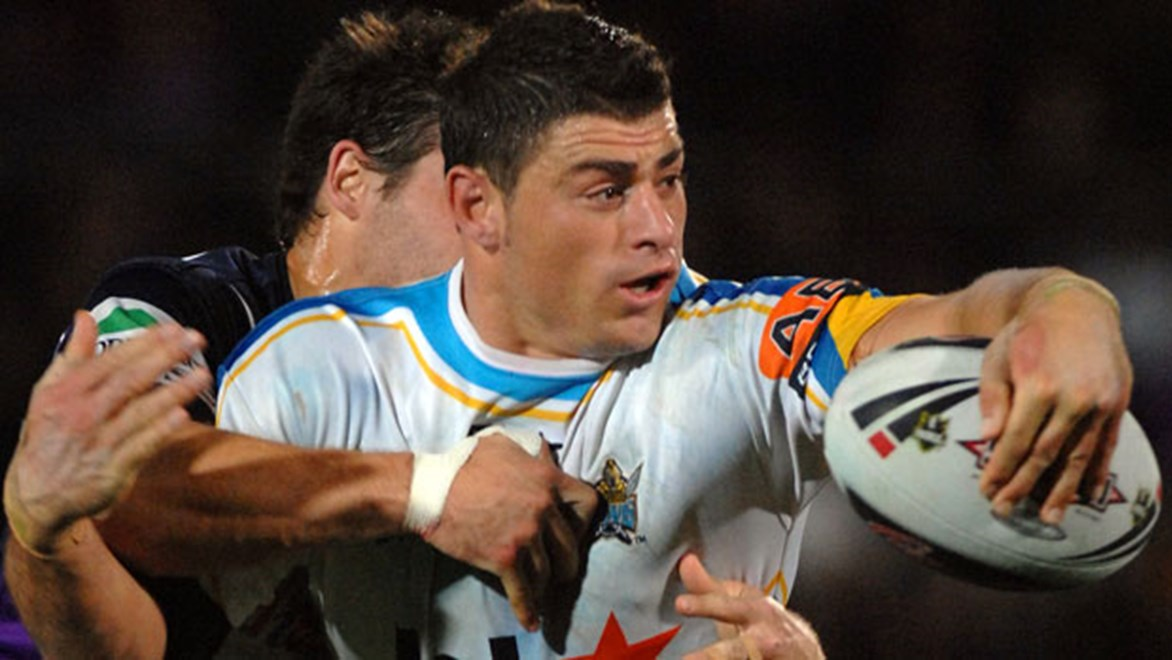 A 25-year-old Mark Minichiello looks to get the ball away in his debut season with the Titans in 2007; the younger Minichiello brother becomes the first player to notch 150 games for the Gold Coast when he runs out against the Warriors on Saturday.