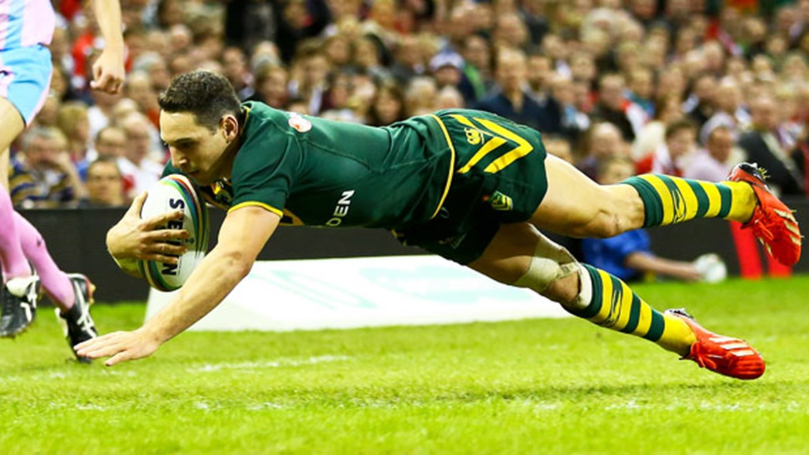 Billy Slater dives over to score against England in the Rugby League World Cup opener.
