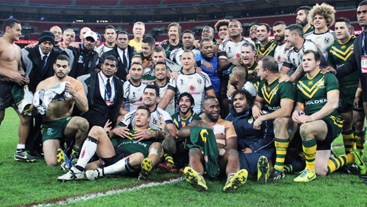 Australia and Fiji players gather for a photo as part of Petero Civoniceva's rugby league farewell.