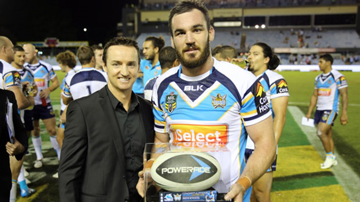 Luke Douglas is presented with an award by Jason Taylor for breaking the record for most consecutive games on Monday night. Copyright: Grant Trouville/NRL Photos