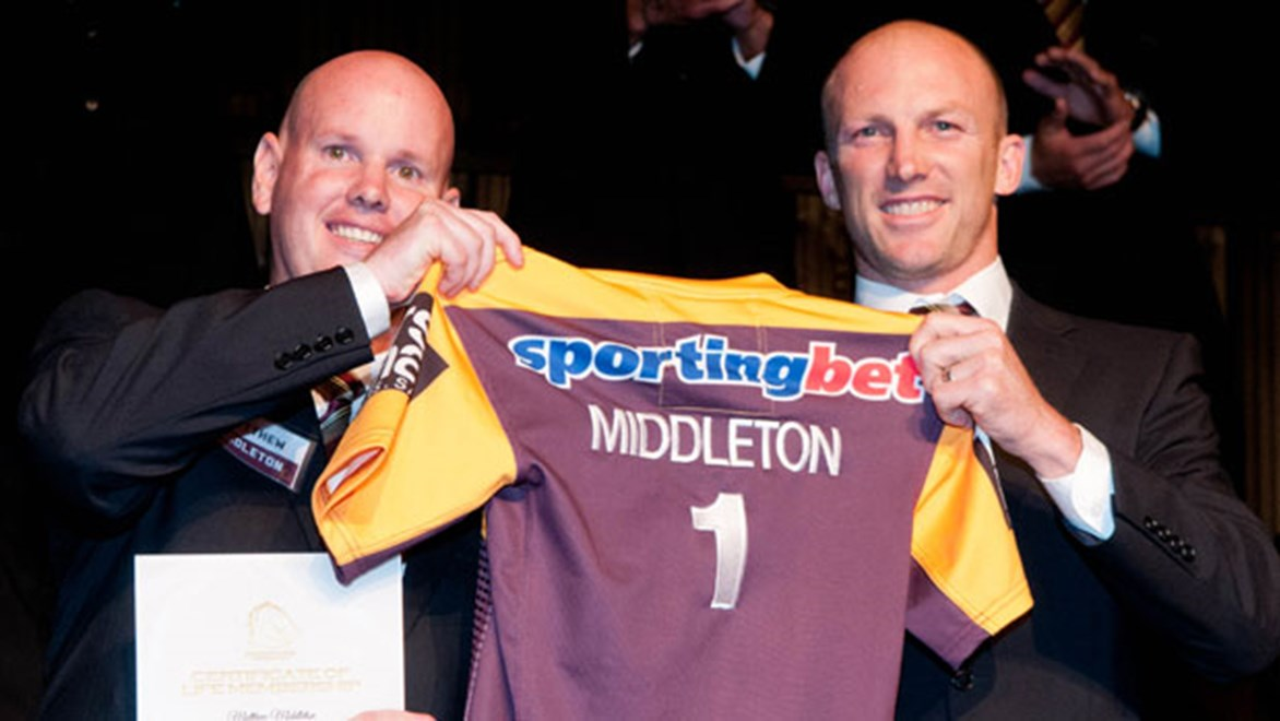 Matt Middleton (left) was honoured by club legend Darren Lockyer when he was awarded life membership of the Brisbane Broncos. Copyright: Courtesy Broncos Media