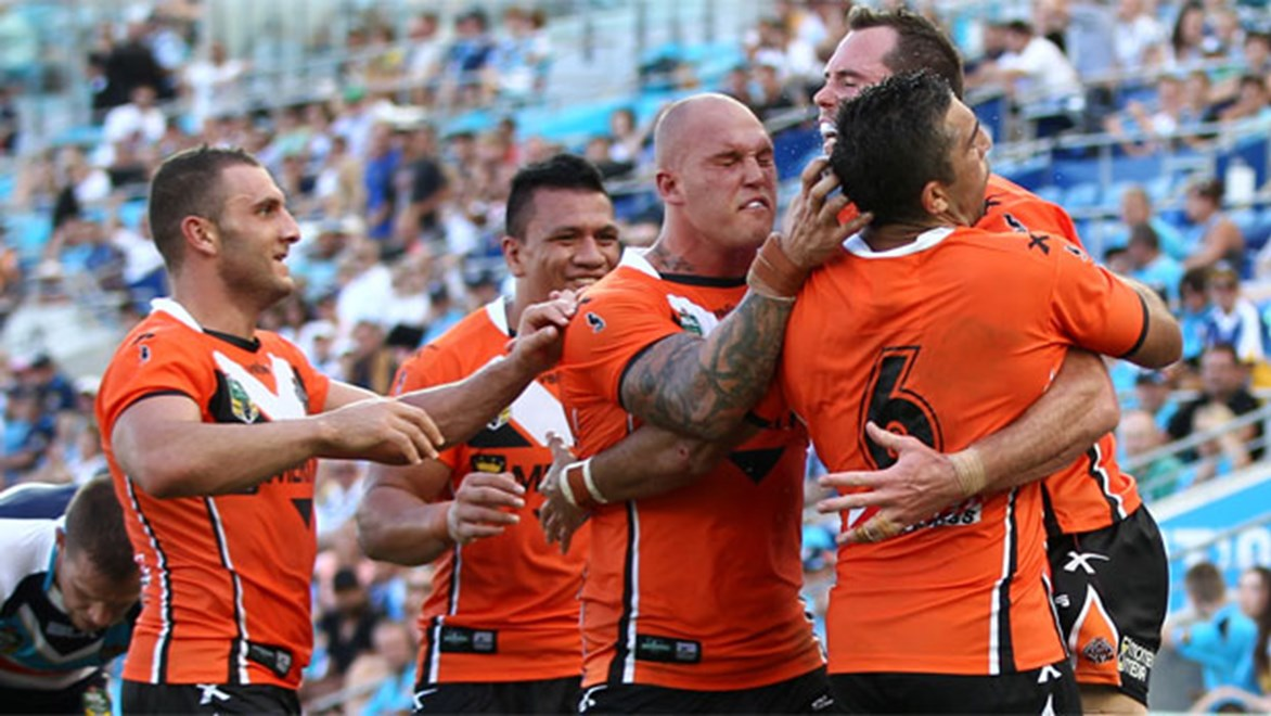 Wests Tigers have inflicted a crushing defeat on the Titans in oppressive heat at Cbus Super Stadium on Sunday afternoon. Copyright: Colin Whelan/NRL Photos.