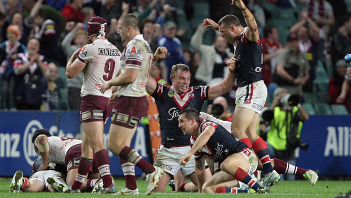 Mitchell Pearce slumps to the ground following the pulsating semi-final between the Roosters and Sea Eagles last year. Copyright: Robb Cox/NRL Photos