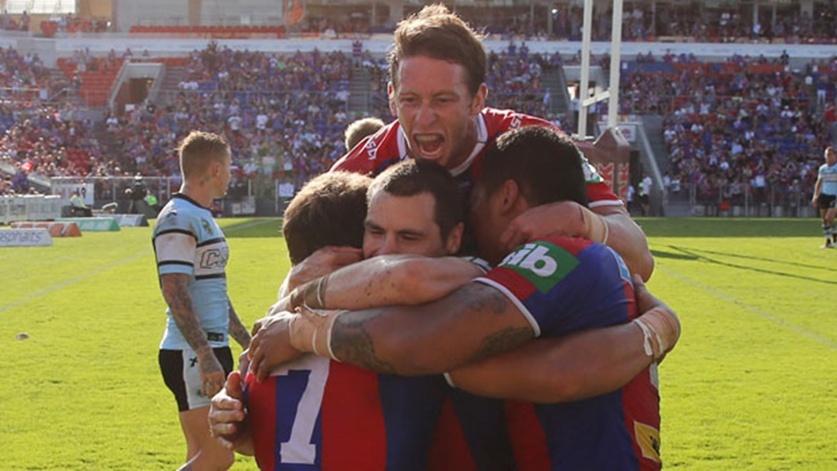 Knights captain Kurt Gidley and his players celebrate a try against the Sharks on an emotional afternoon for the club in the wake of Alex McKinnon's injury. Copyright: Grant Trouville/NRL Photos