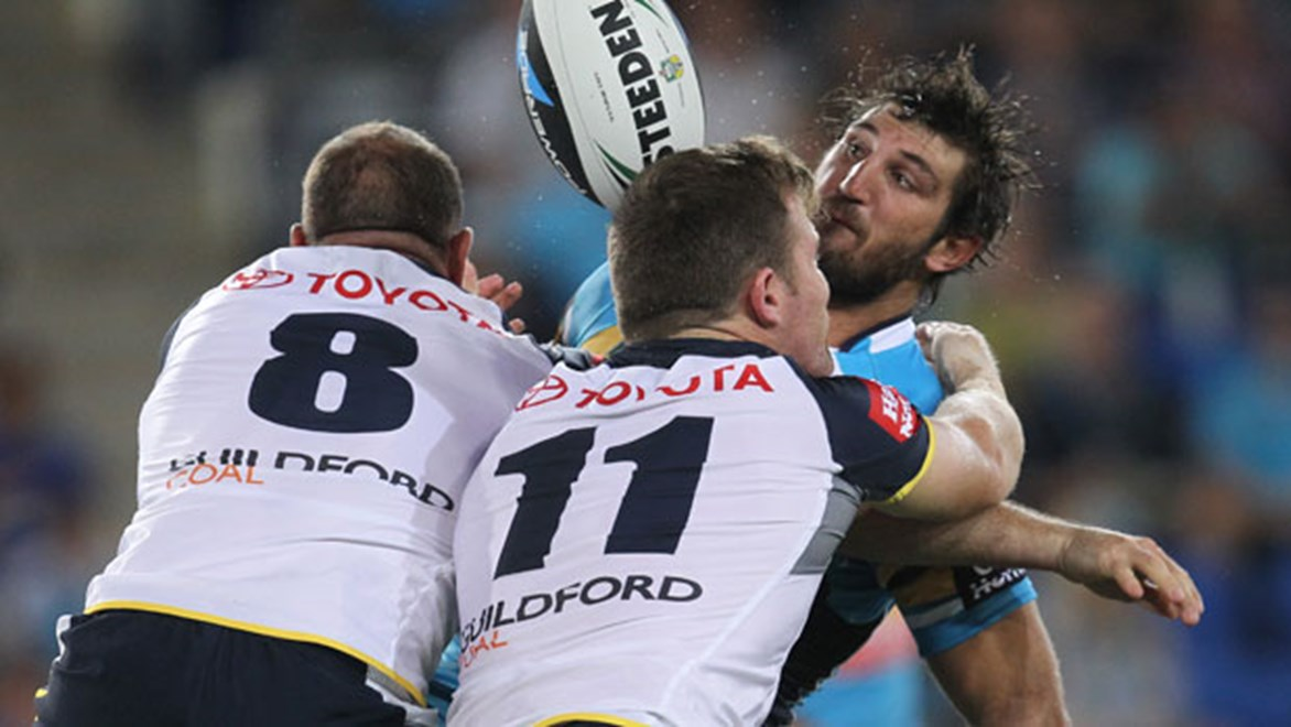 The Cowboys were committed in defence but a woeful completion rate cruelled any chance of victory against the Titans. Copyright: Col Whelan/NRL Photos