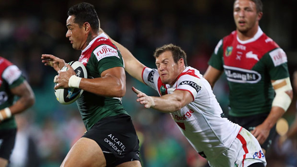 New South Sydney games record holder John Sutton tries to evade Dragons winger Brett Morris at the SCG. Copyright: Robb Cox/NRL Photos