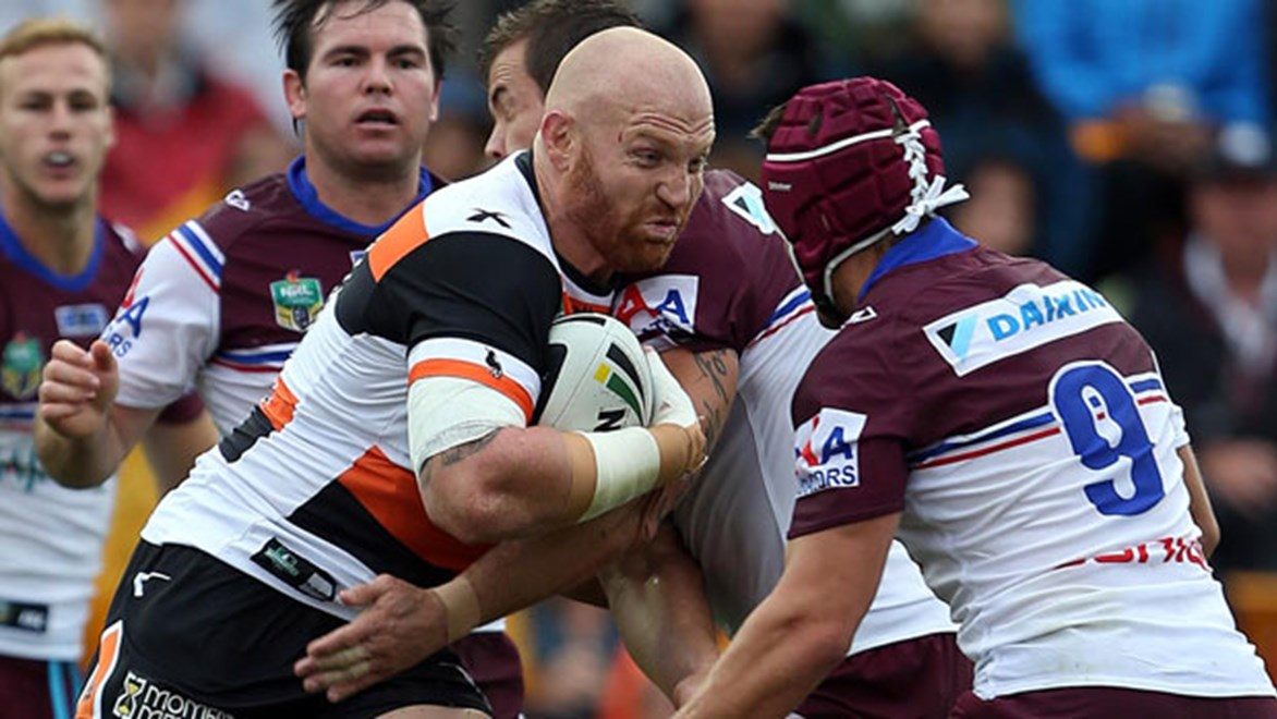 Wests Tigers prop Keith Galloway takes a hit-up during his side's romp over Manly. Copyright: Robb Cox/NRL Photos