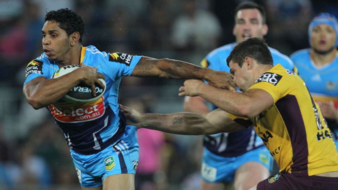 The battle between Titans halfback Albert Kelly and his Broncos opposite Ben Hunt will be a key feature of the south-east Queensland derby. Copyright: Col Whelan/NRL Photos