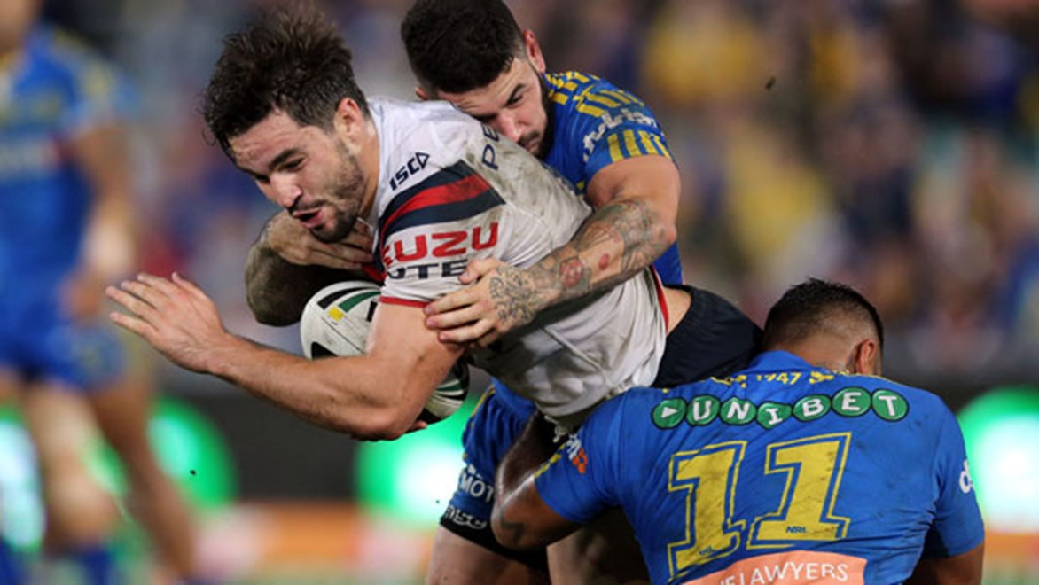 Roosters forward Aiden Guerra takes a hit-up as Eels hooker Nathan Peats closes in during their Saturday night clash in Parramatta. Copyright: Grant Trouville/NRL Photos