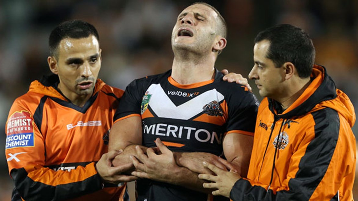 Wests Tigers captain Robbie Farah leaves the field with a suspected dislocated elbow during his side's win over the Cowboys on Saturday. Copyright: Robb Cox/NRL Photos