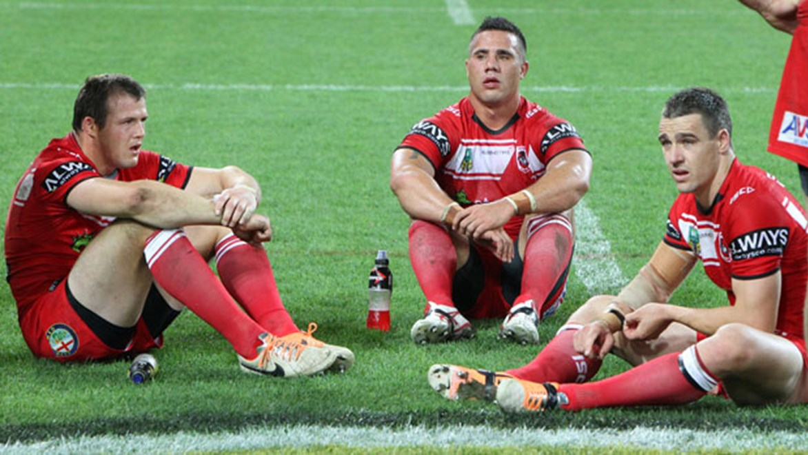 Shattered Dragons players Brett Morris, Bronson Harrison and Michael Witt absorb their shock loss to the Storm. Copyright: Brett Crockford/NRL Photos
