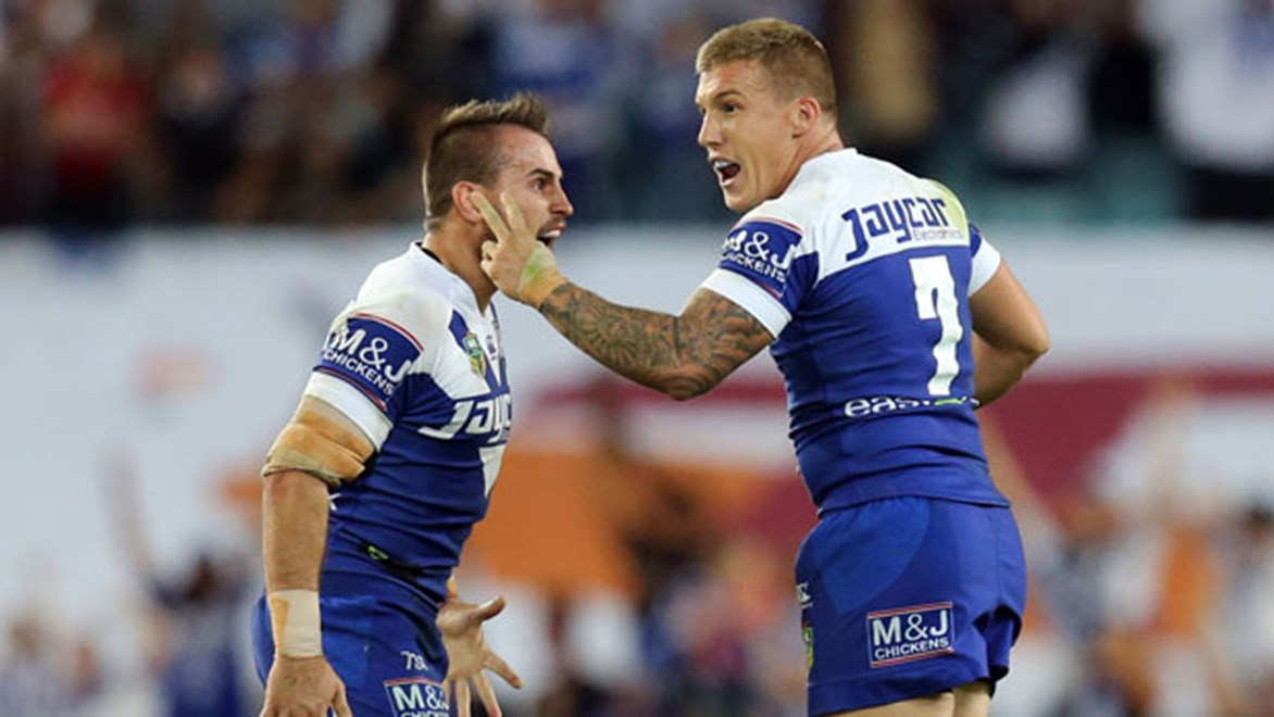 Bulldogs halfback Trent Hodkinson celebrates a match-winning field goal.