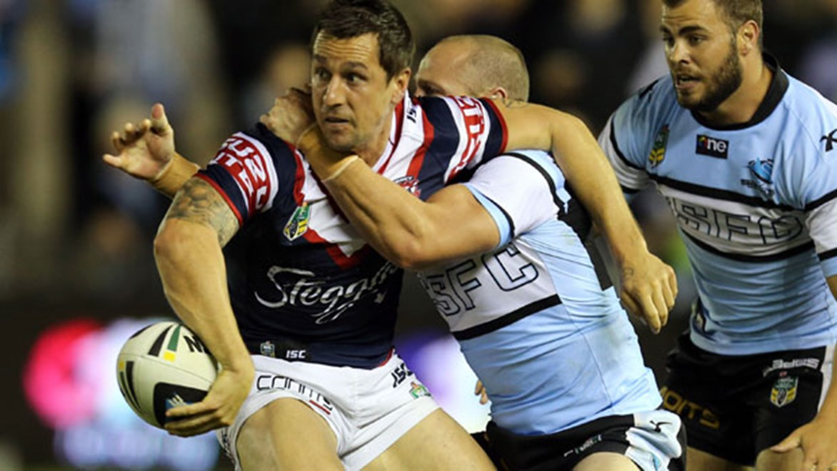 Roosters halfback Mitchell Pearce tries to offload during his side's Saturday night clash against the Sharks at Remondis Stadium.