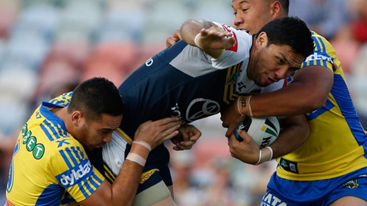 Cowboys winger Curtis Rona takes on the Parramatta defence during their Saturday night clash at 1300SMILES Stadium.