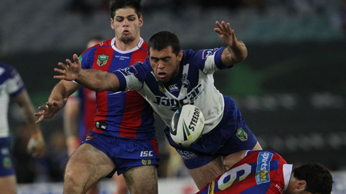 Bulldogs forward Dale Finucane scrambles for the ball during his side's Saturday night clash against the Knights at ANZ Stadium.