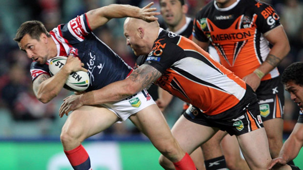 Mitchell Pearce's battle with Luke Brooks will be pivotal to the outcome of the Roosters-Tigers clash.