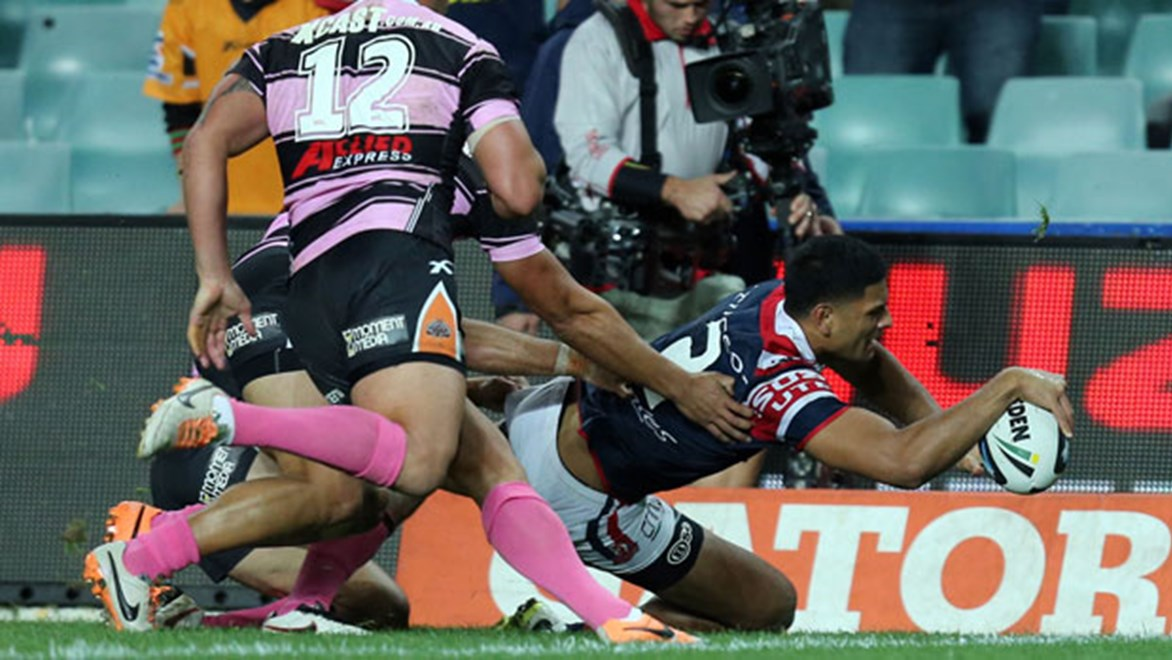 Roosters winger Daniel Tupou crosses the stripe for his first try this evening against the Wests Tigers.