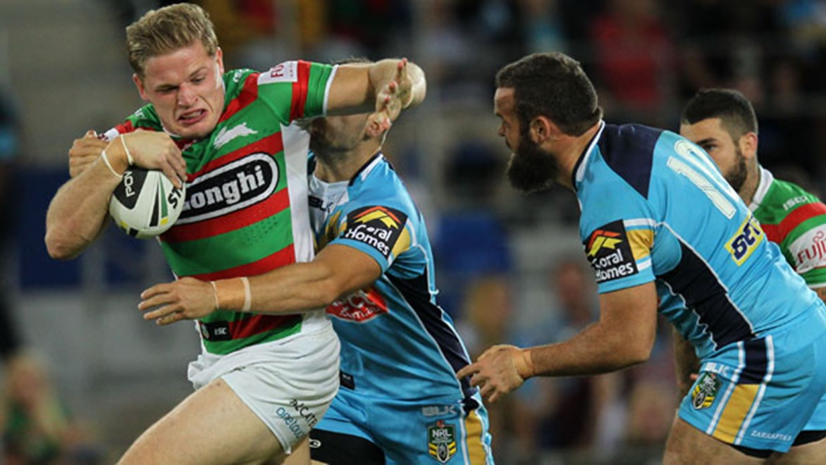Rabbitohs prop George Burgess crashes into the Titans defence during their Saturday night clash.