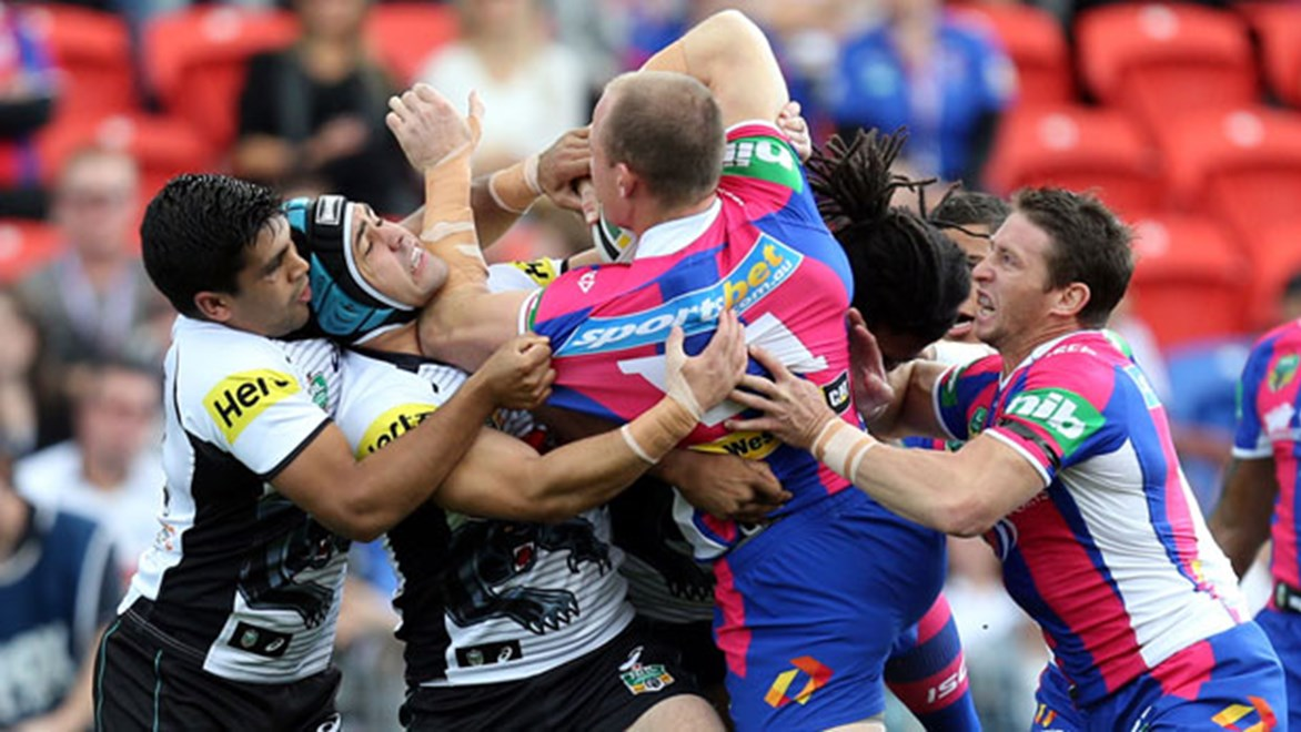 Knights forward Beau Scott crashes into the Panthers defence during their Sunday clash at Hunter Stadium