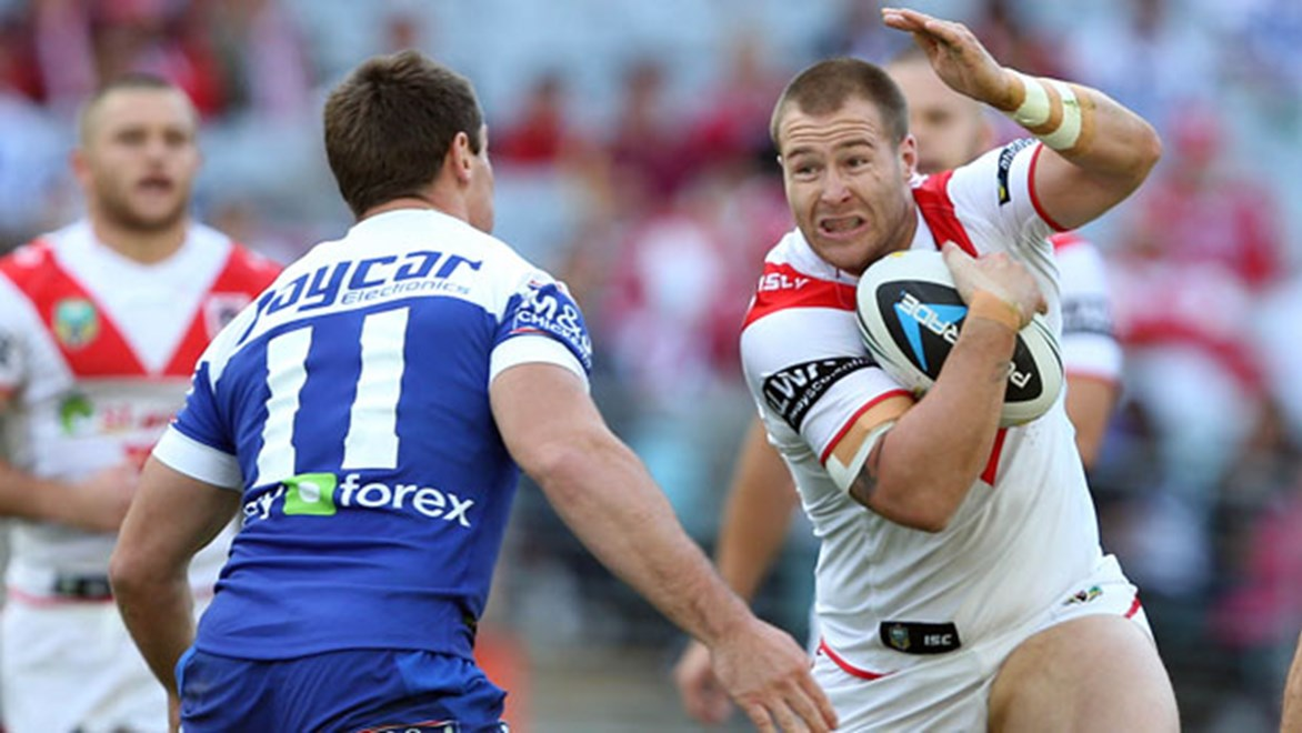 Dragons lock Trent Merrin takes a charge during his side's Sunday clash against the Bulldogs.