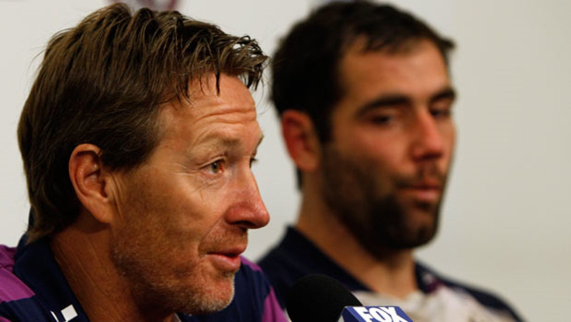 Storm coach Craig Bellamy and skipper Cameron Smith address the media.