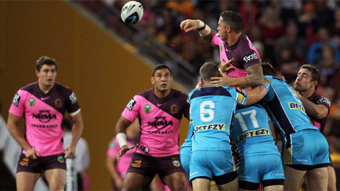 Corey Parker gets an offload away after being swarmed by Titans defenders.