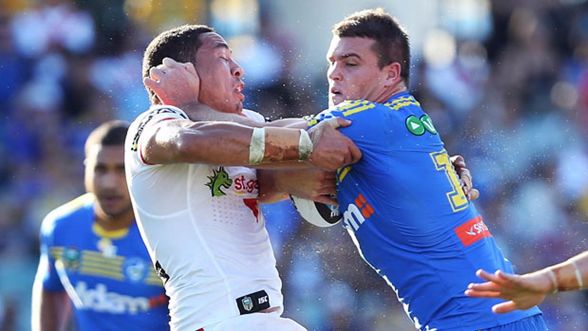 Eels forward Darcy Lussick crashes into the Dragons defence during their Saturday clash at Pirtek Stadium.
