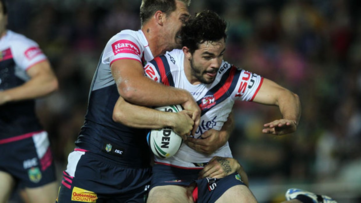Roosters forward Aidan Guerra is wrapped up by the Cowboys defence during Saturday's clash in Townsville.