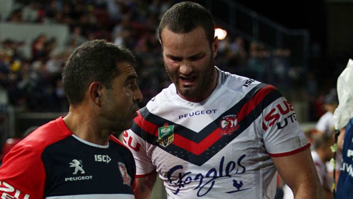 Roosters, NSW and Australia forward Boyd Cordner leaves the field in pain after injuring his ankle against the Cowboys on Saturday.