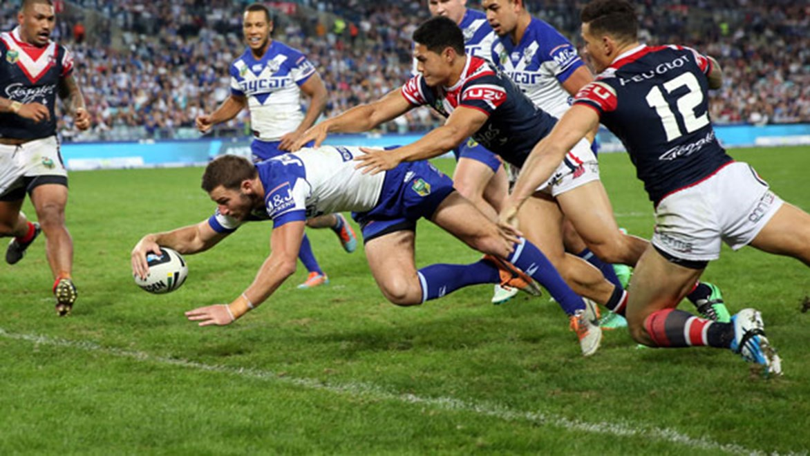 Bulldogs winger Mitch Brown crosses for a try during the first half of his team's Friday clash against the Roosters at ANZ Stadium.