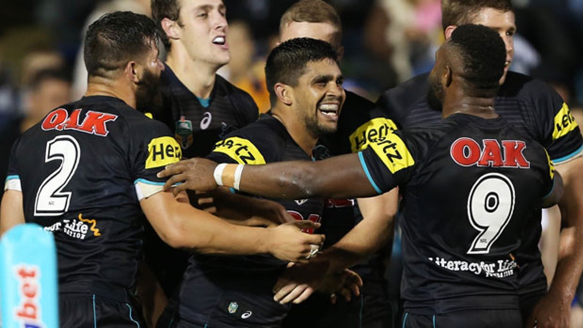 Penrith forward Tyrone Peachey celebrates one of two tries he scored in a big win over the Eels on Friday night.