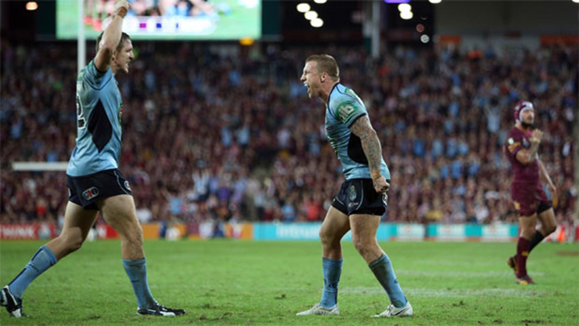 Dizzying heights... Bulldogs halfback Trent Hodkinson gets a taste of what it's like to come down from that Origin mountain for Friday night's clash against Manly.