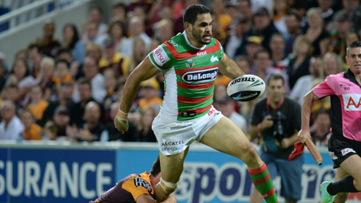 Greg Inglis streaks away to score the Rabbitohs' third try in the opening 15 minutes of their victory over the Broncos in Round 8.