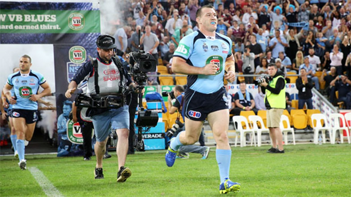 Paul Gallen leads the NSW Blues out onto the field in Origin I.