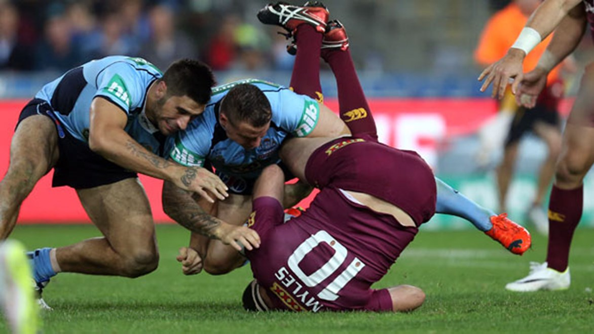 Anthony Watmough is hoping to get his Grade 2 charge for this tackle on Nate Myles in Origin II downgraded at the judiciary on Thursday night.