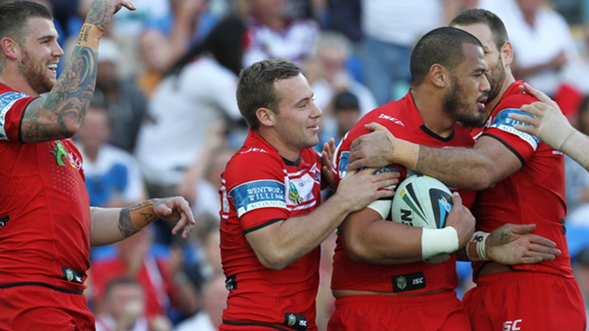 Josh Dugan celebrates with his Dragons teammates during their 19-18 win over the Titans in Round 15.