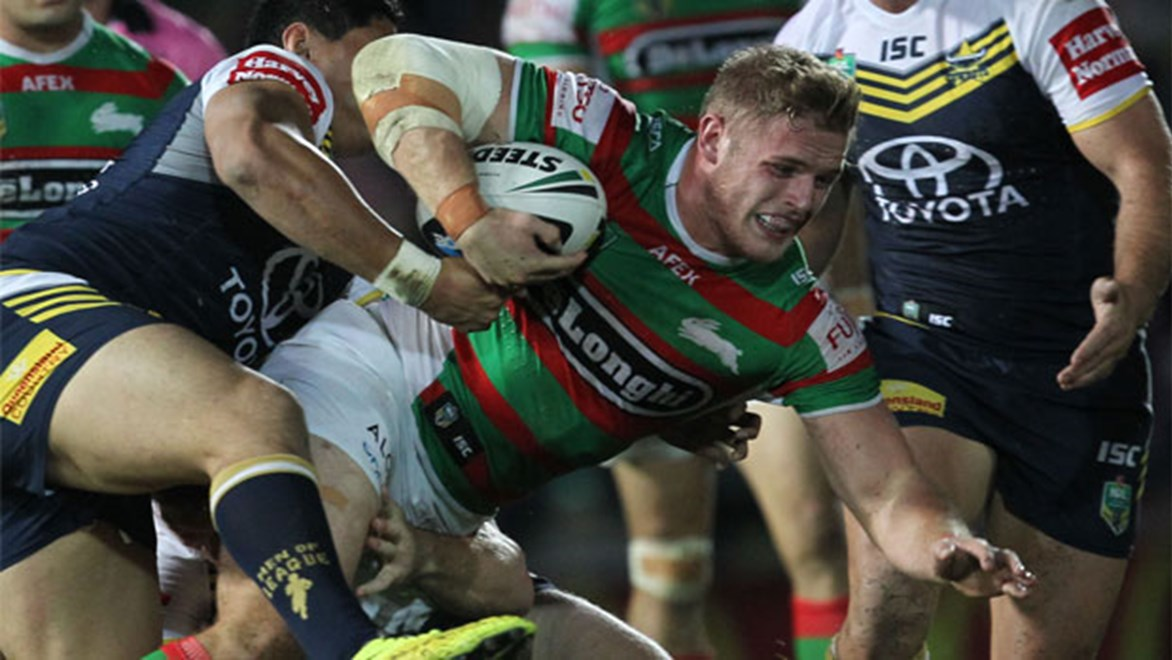 Rabbitohs prop Tom Burgess is brought down by Cowboys defenders at 1300 SMILES Stadium in Round 16.